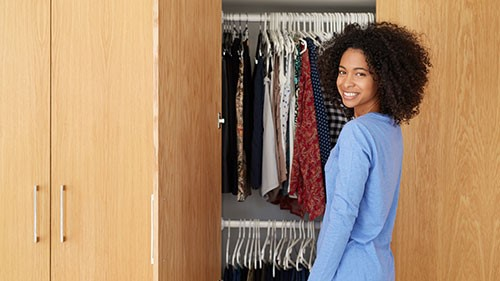 If your closet is brimming with clothes that you no longer wear or might be saving for another season, consider trimming down and taking the capsule wardrobe approach.